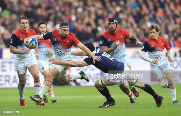 Guilhem Guirado of France is tackled by Tim Swinson of Scotland during the RBS Six Nations match between France and Scotland at Stade de France on...