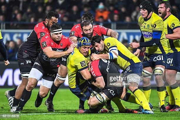 Guilhem Guirado of Toulon Flip Van Der Merwe and Remi Lamerat of Clermont during the Top 14 match between Clermont Auvergne and RC Toulon on January...