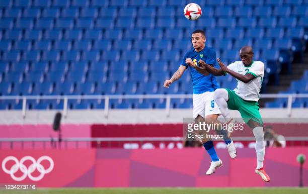 Guilherme Arana of Brazil and Saud Abdulhamid of Saudi Arabia battle for the ball during the Men's Group D match between Saudi Arabia and Brazil on...