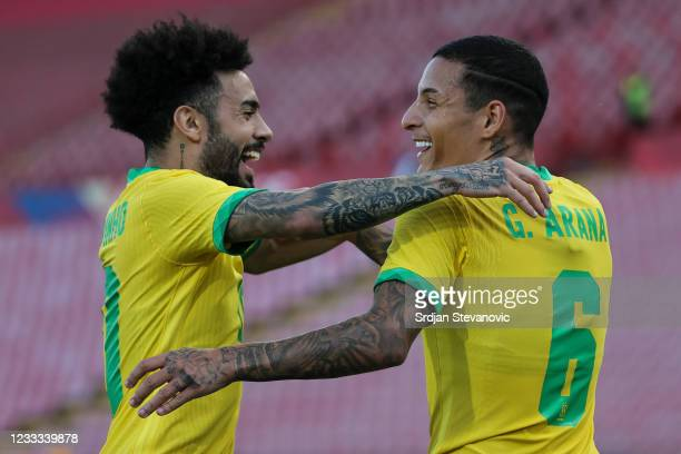 Guilherme Arana of Brazil celebrates after scoring a goal with Claudinho during the International football friendly match between Serbia U21 and...