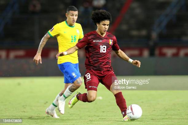Guilherme Arana of Brazil competes for the ball with Eduard Bello of Venezuela during a match between Venezuela and Brazil as part of South American...