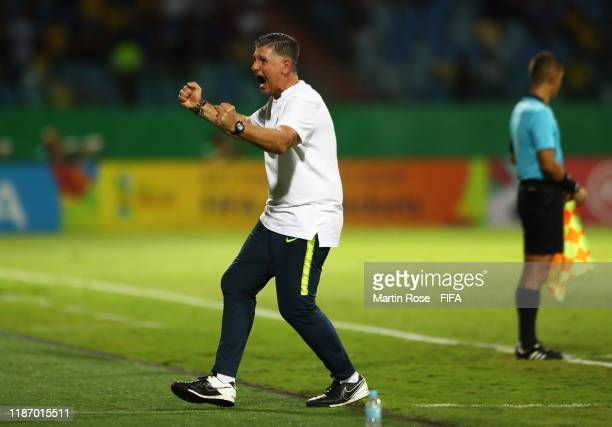 Guilherme Dalla Dea, Coach of Brazil celebrates his sides second goal scored by Peglow of Brazil during the FIFA U-17 World Cup Quarter Final match...
