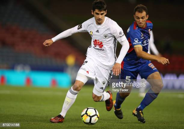 Guilherme Finkler of the Phoenix contests the ball with Ben Kantarovski of the Jets during the round five ALeague match between the Newcastle Jets...