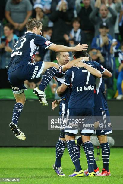 Guilherme Finkler of the Victory celebrates his goal with James Troisi and Adrian Leijer during the round 10 ALeague match between the Melbourne...