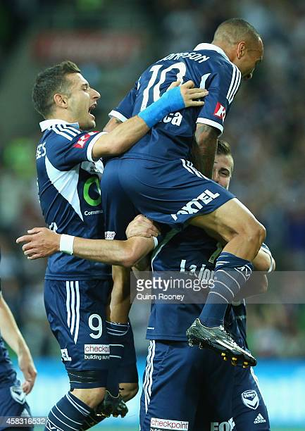 Guilherme Finkler of the Victory is congratulated by Kosta Barbarouses and Archie Thompson after scoring a goal during the round four ALeague match...
