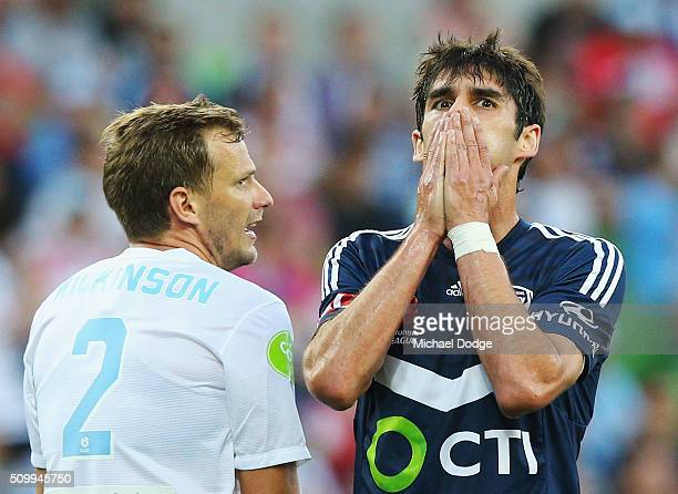 Guilherme Finkler of the Victory reacts after missing a goal next to Alexander Wilkinson of the City during the round 19 ALeague match between...