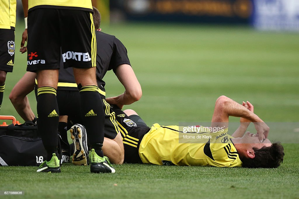 Guilherme Finkler of Wellington Phoenix lies injured during the round nine A-League match between Adelaide United and the Wellington Phoenix at Coopers Stadium on December 4, 2016 in Adelaide, Australia.