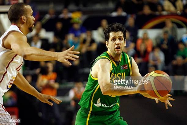 Guilherme Giovannoni of Brazil hides the ball from Ricardo Sanchez of Puerto Rico during the Brazil vs Puerto Rico 2011 FIBA Americas Championship...