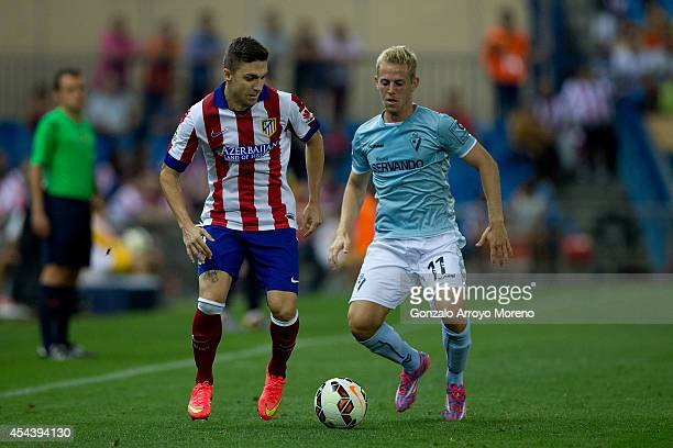 Guilherme Madalena Siqueira of Atletico de Madrid competes for the ball with Daniel Nieto Vela of SD Eibar during the La Liga match between Club...
