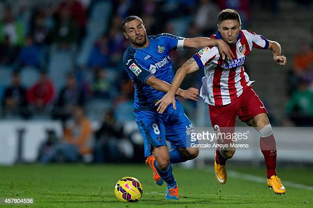 Guilherme Madalena Siqueira of Atletico de Madrid competes for the ball with Mehdi Lacen of Getafe CF during the La Liga match between Getafe CF and...
