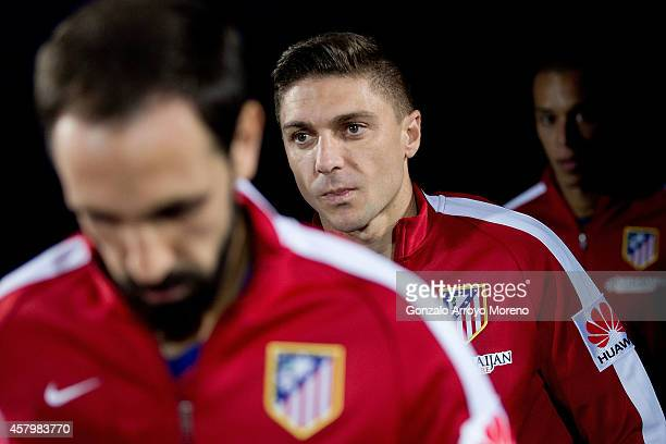 Guilherme Madalena Siqueira of Atletico de Madrid enters the mitch between his teammates prior to start the La Liga match between Getafe CF and Club...