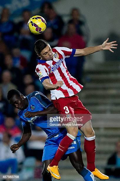 Guilherme Madalena Siqueira of Atletico de Madrid wins the header afterPapa Diawara Babacar alias Baba of Getafe CF during the La Liga match between...