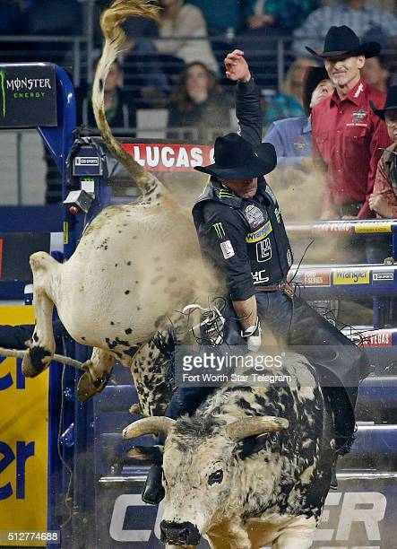 Guilherme Marchi rides the bull 'Air Time' during the PBR Iron Cowboy bull riding competition at ATT Stadium in Arlington Texas on Saturday Feb 27...