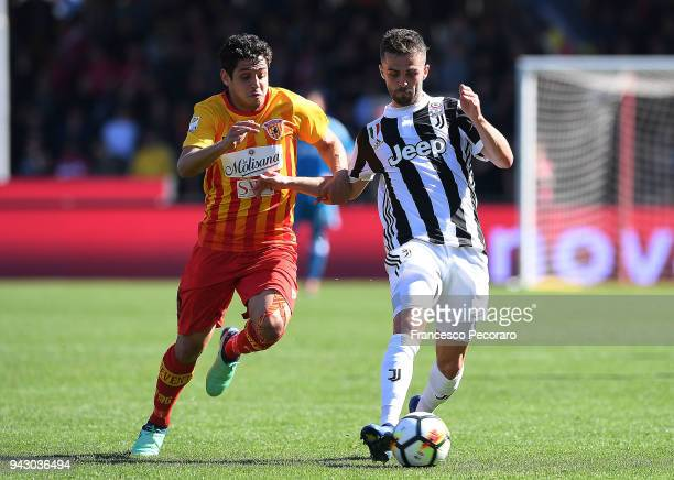 Guilherme of Benevento Calcio vies with Miralem Pjanic of Juventus during the serie A match between Benevento Calcio and Juventus at Stadio Ciro...