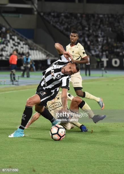 Guilherme of Botafogo de Futebol e Regatas in action against Mario Pineida of Barcelona SC during Copa Libertadores of America match between Botafogo...