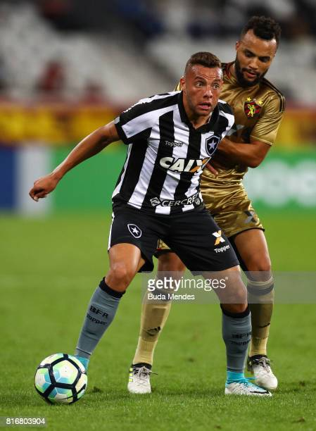 Guilherme of Botafogo struggles for the ball with Samuel Xavier of Sport Recife during a match between Botafogo and Sport Recife as part of...