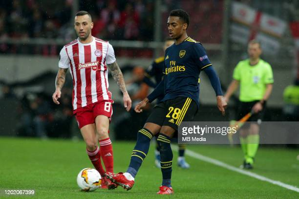 Guilherme of Olympiacos FC and Joe Willock of Arsenal FC during the UEFA Europa League Round of 32 first leg match between Olympiacos FC and Arsenal...