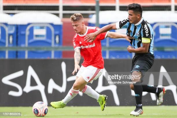 Guilherme Pato of Internacional and Matheus Nunes of Gremio fisght for the ball controls the ball during the match between Internacional and Gremio...