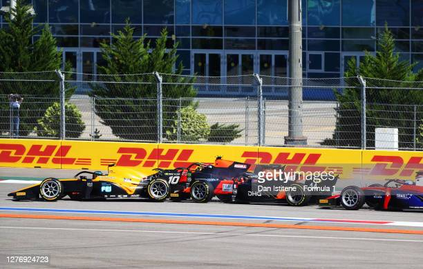 Guilherme Samaia of Brazil and Campos Racing and Giuliano Alesi of France and MP Motorsport make contact at the start during the Formula 2...