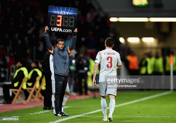Guilherme Siqueira of Atletico Madrid leaves the pitch after suffering an injury during the UEFA Champions League round of 16 match between Bayer 04...