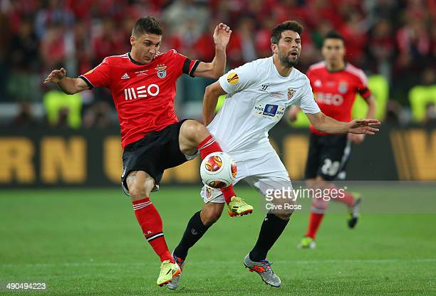 Guilherme Siqueira of Benfica clashes with Coke of Sevilla during the UEFA Europa League Final match between Sevilla FC and SL Benfica at Juventus...