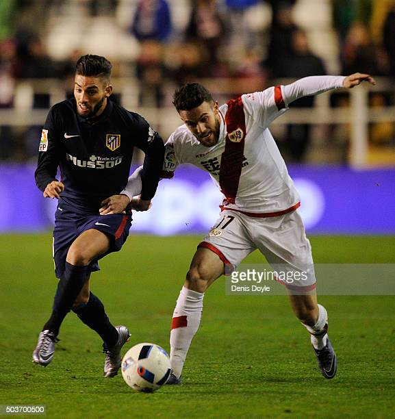 Guilherme Siqueira of Club Atletico de Madrid battles for the ball against Quini Marin of Rayo Vallecano de Madrid during the Copa del Rey Round of...