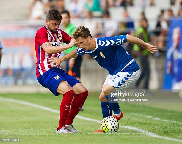 Guilherme Siqueira of Club Atletico de Madrid duels for the ball with Susaeta of Real Oviedo during a pre season friendly match between Real Oviedo...