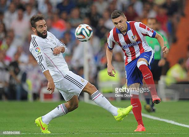 Guilherme Siqueira of Club Atletico de Madrid is tackled by Daniel Carvajal of Real Madrid during the Supercopa first leg match between Real Madrid...