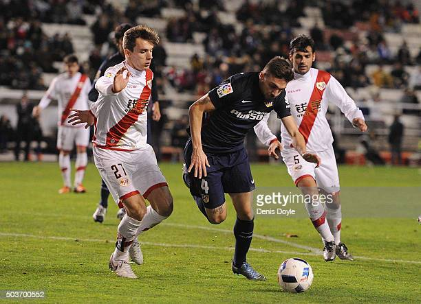 Guilherme Siqueira of Club Atletico de Madrid tries to beat Diego Llorente of Rayo Vallecano de Madrid during the Copa del Rey Round of 16 First Leg...