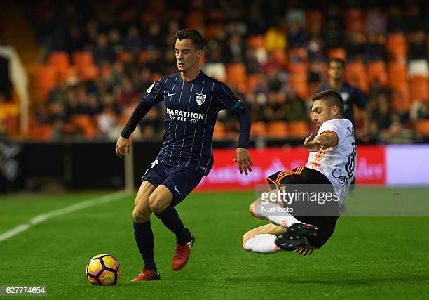 Guilherme Siqueira of Valencia CF and Juanpi Anor of Malaga CF during the La Liga match between Valencia CF vs Malaga CF at Estadio de Mestalla on...