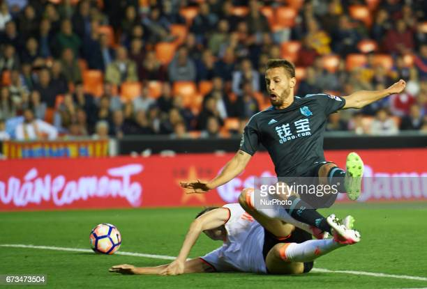 Guilherme Siqueira of Valencia CF and Sergio Canales of Real Sociedad during their La Liga match between Valencia CF and Real Sociedad at the...