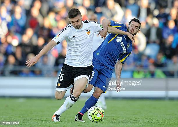 Guilherme Siqueira of Valencia CF battles for the ball against Victor Rodriguez of Getafe during the La Liga match between Getafe CF and Valencia CF...