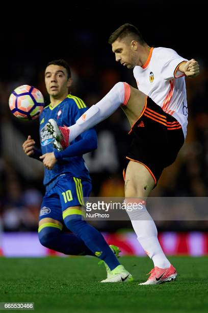 Guilherme Siqueira of Valencia CF competes for the ball with Iago Aspas of Real Club Celta de Vigo during the La Liga match between Valencia CF and...