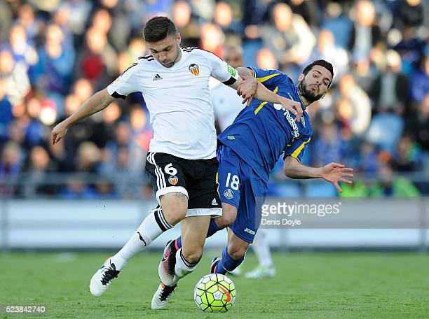 Guilherme Siqueira of Valencia CF in action against Victor Rodriguez of Getafe during the La Liga match between Getafe CF and Valencia CF at Coliseum...