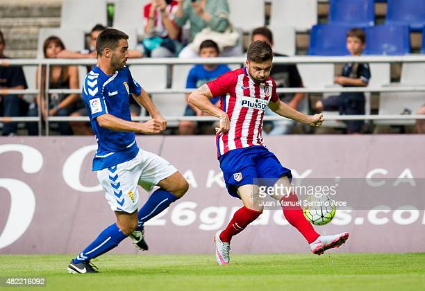 Guilherme Siqueira ofÊClub Atletico de Madrid duels for the ball with Hector Verdes of Real Oviedo during a pre season friendly match between Real...