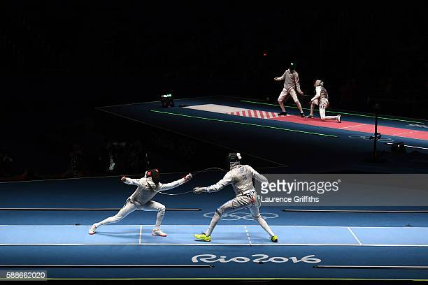 Guilherme Toldo of Brazil competes against Andrea Cassara of Italy and Sheng Lei of China competes against Erwan le Pechoux of France during a Men's...