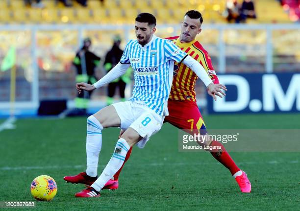 Guilio Donati of Lecce competes for the ball with Mattia Valoti of Spal during the Serie A match between US Lecce and SPAL at Stadio Via del Mare on...
