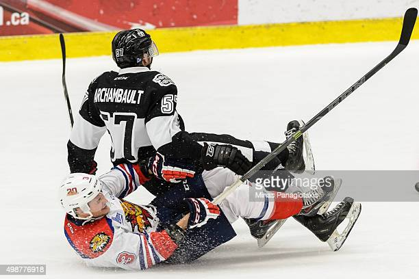 Guillaume Archambault of the Blainville-Boisbriand Armada falls onto Austin Kosack of the Moncton Wildcats during the QMJHL game at the Centre...