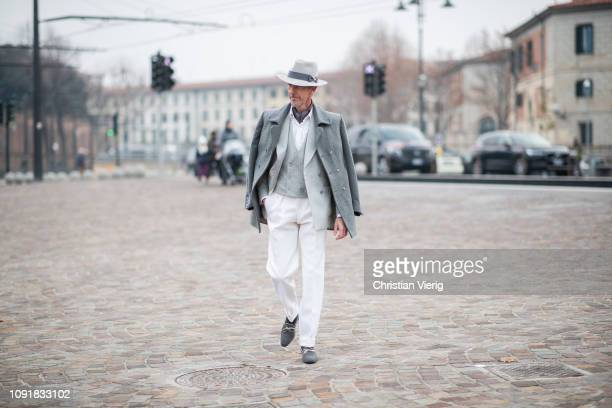 Guillaume Bo is seen wearing grey hat jacket suit white pants vest striped blazer during the 95th Pitti Uomo at Fortezza Da Basso on January 09 2019...