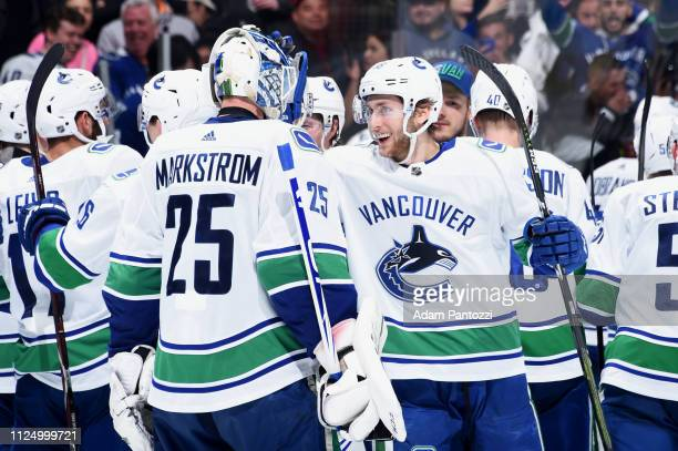 Guillaume Brisebois of the Vancouver Canucks celebrates with goaltender Jacob Markstrom after the Canucks defeated the Los Angeles Kings in a...