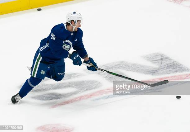Guillaume Brisebois of the Vancouver Canucks reaches for a pass on the first day of the Vancouver Canucks NHL Training Camp on January 2021 at Rogers...