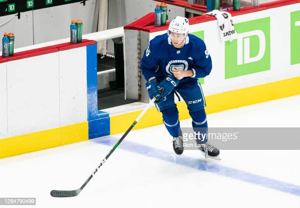Guillaume Brisebois of the Vancouver Canucks steps on the ice on the first day of the Vancouver Canucks NHL Training Camp on January 2021 at Rogers...