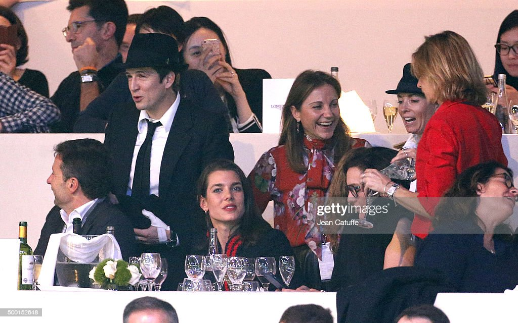 Guillaume Canet and Charlotte Casiraghi attend the 'Style and Competition' show jumping charity event benefitting 'AMADE' on day three of the Longines Paris Masters 2015 held at the Paris-Nord Villepinte Exhibition Center on December 5, 2015 in Villepinte nearby Paris, France.