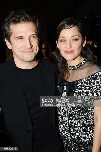 "Guillaume Canet and Marion Cotillard attend the ""Cesar - Revelations 2020"" Photocall at Petit Palais on January 13, 2020 in Paris, France."