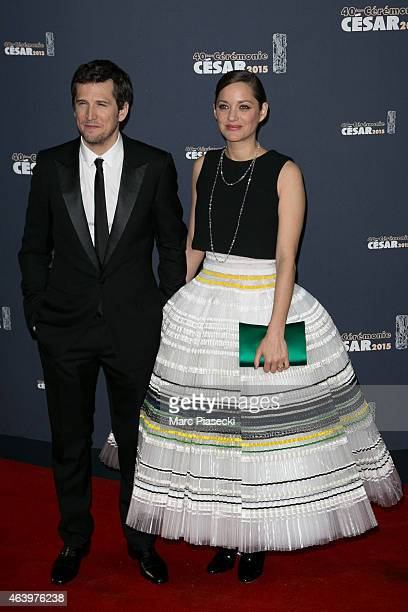 Guillaume Canet and Marion Cotillard attend the 'CESARS' Film awards at Theatre du Chatelet on February 20, 2015 in Paris, France.