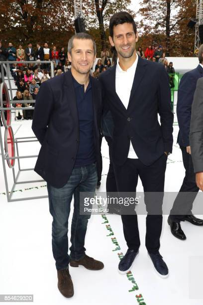 Guillaume Canet and Novak Djokovic attend the Lacoste show as part of the Paris Fashion Week Womenswear Spring/Summer 2018 on September 27 2017 in...