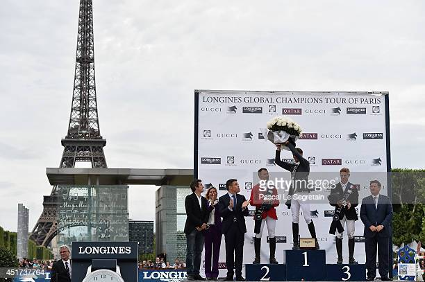 Guillaume Canet and Virginie CouperieEiffel pose with Winners of the 'Longines Global Champions Tour Grand Prix of Paris Competition' Pius Schwizer...