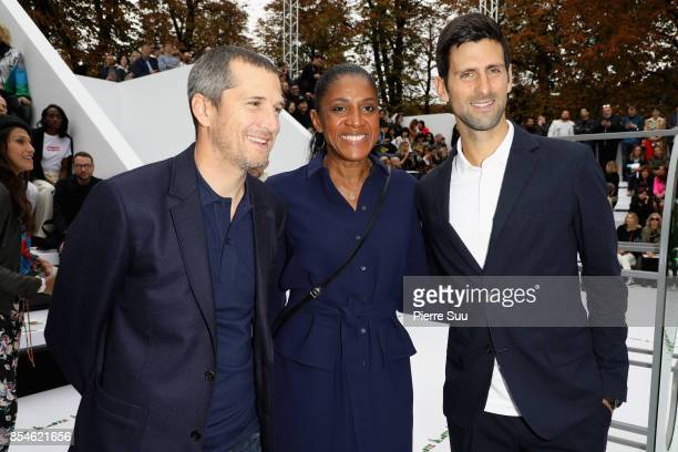 Guillaume Canet MarieJose Perec and Novak Djokovic attend the Lacoste show as part of the Paris Fashion Week Womenswear Spring/Summer 2018 on...