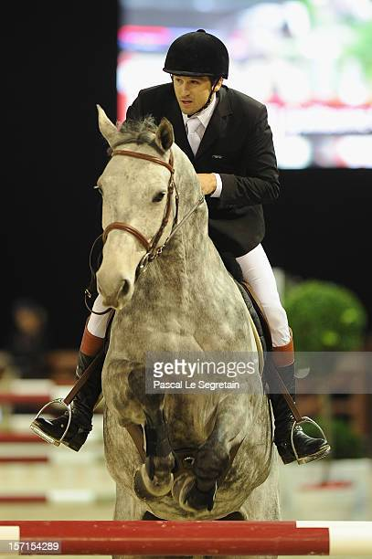 Guillaume Canet rides B during the Masters Grand Slam race at the Gucci Paris Masters 2012 at Paris Nord Villepinte on November 29 2012 in Paris...