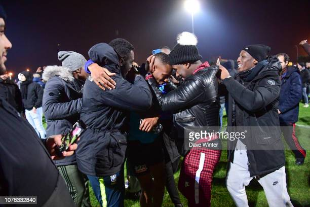 Guillaume Dali of Noisy Le Grand FC is mobbed by supporters after his team wins the French Cup match between Noisy le Grand and Gazelec Ajaccio on...
